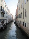 Gondolas and canals in Venice, Italy -- oh my!. Ancient buildings and waterways, with gondolas floating through them is the epitome of Venice,Italy. Here are Stock Photo