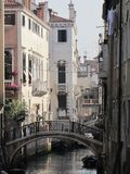Gondolas and canals in Venice, Italy -- oh my!. Ancient buildings and waterways, with gondolas floating through them is the epitome of Venice,Italy. Here are Stock Photography