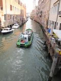 Gondolas and canals in Venice, Italy -- oh my!. Ancient buildings and waterways, with gondolas floating through them is the epitome of Venice,Italy. Here are Stock Image