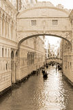 Gondolas through the canals of Venice, sepia tone Royalty Free Stock Image