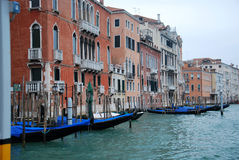 Gondolas in channel in Venice Stock Images