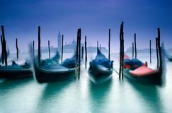 Venice Gondolas with church of San Giorgio Maggiore in the background Venice royalty free stock image