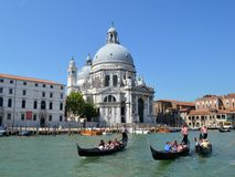 Gondolas and church Royalty Free Stock Photos