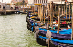 Gondolas docked at the harbour front in Venice Royalty Free Stock Photos