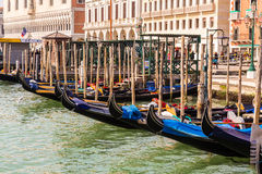Gondolas docked at the harbour in Venice Royalty Free Stock Photos
