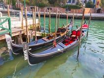 Gondolas docked Stock Photos