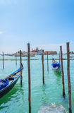 Gondolas on the docks in Venice Stock Photos