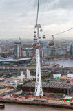 Gondolas of the Emirates Air Line cable car in London on a rainy day Royalty Free Stock Images