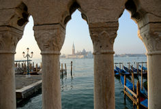 Gondolas floating in the Grand Canal with Bridge as foreground Royalty Free Stock Photography