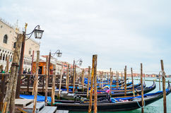 Gondolas floating on the Grand Canal on a quiet day of spring, Venice, Italy Stock Images