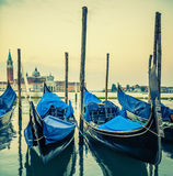 Gondolas floating in the Grand Canal at sunset Royalty Free Stock Photos