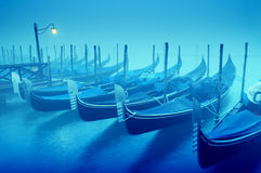 Gondolas in the fog Stock Photography
