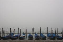 Gondolas and fog Stock Photography