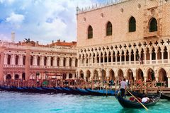 Gondolas and gondolier in front of Ducale museum Royalty Free Stock Photography