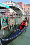 Gondolas and gondoliers on the Grand Canal in Venice, Italy. Two Gondoliers On The Docks Awaiting Tourists In Venice Royalty Free Stock Photography