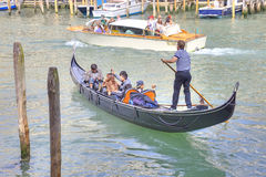 Gondolas and gondoliers Royalty Free Stock Photo