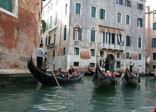 Gondolas. And gondoliers with passengers Stock Photo