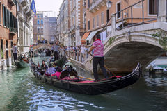Gondolas and gondoliers Stock Photos