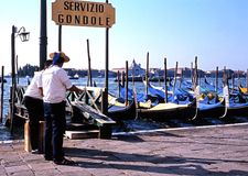 Gondolas and Gondoliers, Venice. Royalty Free Stock Photography