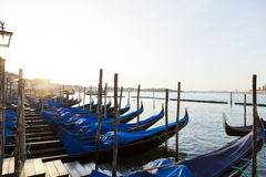 Gondolas on Grand Canal. And in Venice early in the morning Royalty Free Stock Photo