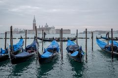 Gondolas on the Grand Canal, Venice. San Giorgio island with church and bell tower in the distance. stock photos