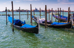 Gondolas in lagoon of Venice, Italy. Venician gondolas in romantic lagoon, Europe Royalty Free Stock Images