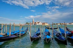 Gondolas and in lagoon of Venice by Saint Mark San Marco square royalty free stock photography