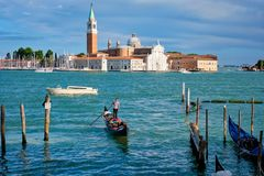 Gondolas and in lagoon of Venice by Saint Mark San Marco square stock images