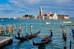 Gondolas and in lagoon of Venice by Saint Mark San Marco square royalty free stock images