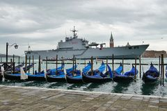 Gondolas and military ship in the Venetian laguna Royalty Free Stock Images