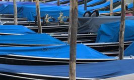 Gondolas moored along the canal, Venice. Stock Photo