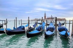 Gondolas moored in front of San Giorgio Maggiore Stock Photography
