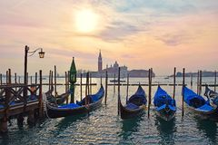 Gondolas moored on the Grand Canal, evening in Venice. Gondolas moored on the Grand Canal in Venice on the background basilica San Giorgio Maggiore, Italy royalty free stock images