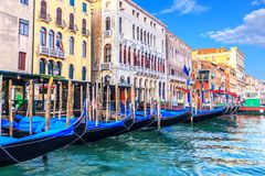 Gondolas moored near old palaces of Venice in the Grand Canal stock image