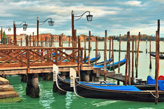 Gondolas moored in row on Grand canal in Venice. Royalty Free Stock Photos