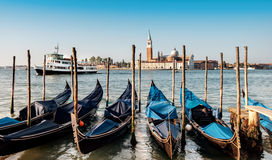 Gondolas moored by Saint Mark square with San Giorgio di Maggior Stock Photos