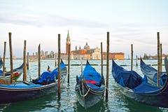 Gondolas moored by Saint Mark square with San Giorgio di Maggiore church in the background - Venice, Venezia, Italy, Europe Stock Image