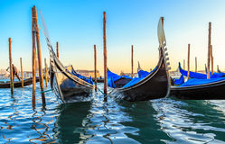 Gondolas moored by Saint Mark square with San Giorgio di Maggiore church in the background - Venice, Venezia, Italy, Europe. Stock Photo