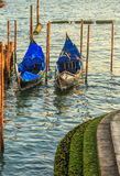 Gondolas moored by Saint Mark square with San Giorgio di Maggiore church in the background - Venice, Venezia, Italy, Europe. Royalty Free Stock Image
