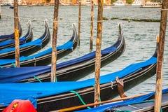 Gondolas moored by Saint Mark square. Venice, Italy, Europe Stock Photos