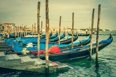 Gondolas moored by Saint Mark square. Venice, Italy, Europe Stock Photo