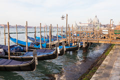 Gondolas moored at San Marco waterfront, Venice, with a view of Basillica Royalty Free Stock Photos
