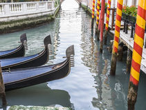 Gondolas moored in side canal, Venice, Italy Stock Images