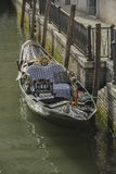 Gondolas moored in a typical venetian canal - Venice stock photography