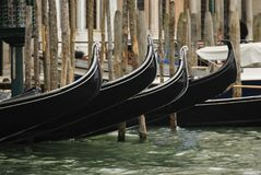 Gondolas moored in a typical venetian canal - Venice Stock Photo