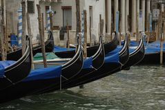 Gondolas moored in a typical venetian canal - Venice Royalty Free Stock Photography