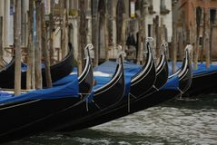 Gondolas moored in a typical venetian canal - Venice Stock Photos