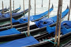 Gondolas Moored in Venetian Lagoon Royalty Free Stock Image