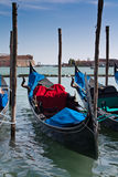 Gondolas on mooring near San Marco. Gandolas station at San Marco in Venice, Italy. Grand canal Royalty Free Stock Photography