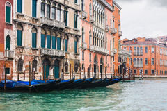 Gondolas near houses in Venice in rain Stock Images